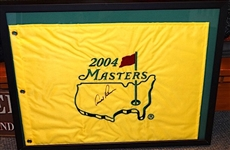 "SIGNED BY ARNOLD PALMER MASTERS FLAG, LAST YEAR PLAYED 2004. FRAMED SIZE 16"" X 20"". COMES WITH 501-c3"