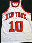 WALT FRAZIER SIGNED JERSEY WITH CERTIFICATE OF AUTHENTICITY FROM MOUNTED MOMORIES