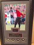 TIGER WOODS FRAMED COLLAGE OF HIS GRAND SLAM VICTORIES WITH FACSIMILE SIGNATURE AND BALL MARKERS