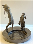 VINTAGE COMPOSITION OF A GOLFER AND CADDY ON A MARBLE BASE
