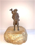 BRONZE GOLFER BOY STATUE ON A SOLID STONE