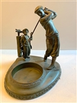 "METAL VINTAGE COMPOSITION OF GOLFER WITH A CADDY TRAY. GOLFER 8 3/4"" HIGH WITH BASE 8.5"" X 8.5"""