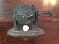 "THE BALL MARKER IS ""THE OMNES GOLF BALL MARKER"", CIRCA 1910, CAST IRON"