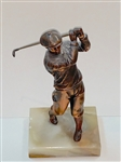 "ANTIQUE STATUE OF A GOLFER ON SEMI PRECIOUS STONE BASE. MEASURING 7-1/2"" HIGH"