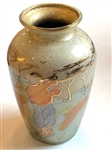 "HASTEY CAT VASE WITH A PAINTING OF A GOLFERS MEN AND WOMEN. STAMPED -""HANDMADE FOR PEBBLE BEACH, 2002"". 5"" TALL"
