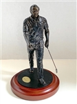 "ARNOLD PALMER DANBURY MINT GOLF SCULPTURE. MEAURING 8"" TALL, SITS ON A CHERRY WOOD BASE."
