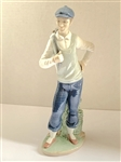 "GOLF SCULPTURE BY NAO MADE BY LLADRO, RETIRED. MEASURING 9.5"" TALL."