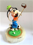 GOOFY DISNEY RON LEE GOLFING TWISTED FIGURINE, LTD. ED.#399/950. HAND PAINTED AND MOUNTED ON AN ONYX BASE.