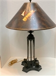 "VINTAGE BRONZE COMPOSITE LAMP WITH 4 GOLF CLUBS AND HAND PAINTED GOLF SCENE LEATHER SHADE. 29"" H"