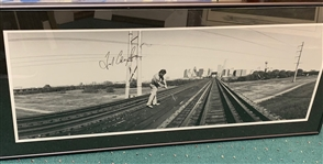 SIGNED FRED COUPLES 1995 POSTER BY ASHWORTH, PLAYING GOLF ON TRAIN TRACKS